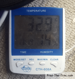 Themometer showing 33 degrees in the grow house