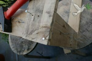 2 nails through the wood to attach the legs