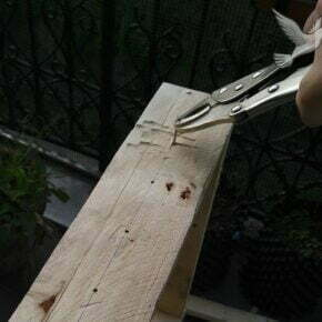 Using wire cutters to pull out the nail