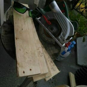Wood cut into 4 pieces with protective glasses and circular saw