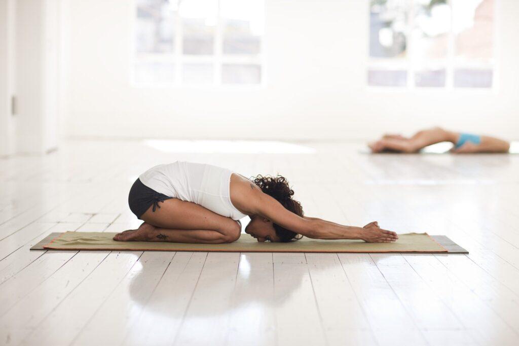 woman doing childpose (yoga)